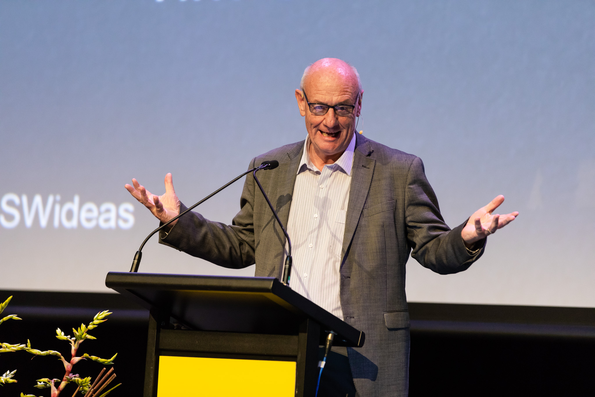 Tim Costello speaking on stage